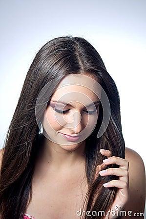 Beautiful caucasian girl holding her hair