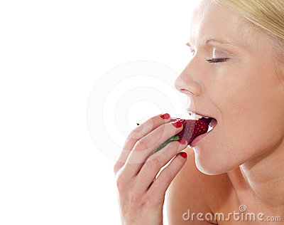 Beautiful caucasian lady tasting yummy strawberry