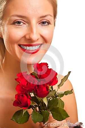 Beautiful caucasian woman with red roses isolated
