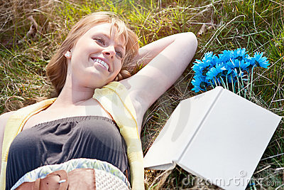 Beautiful Caucasian woman relaxing outdoor
