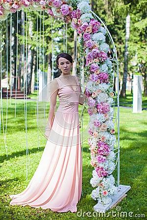 Beautiful charming young woman in wonderful dress