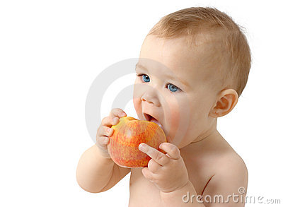 Beautiful child eats red apple