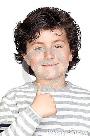Beautiful child with striped sweater  saying OK