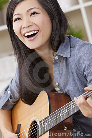 Beautiful Chinese Oriental Woman Smiling & Guitar