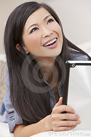 Beautiful Chinese Woman Using Tablet Computer