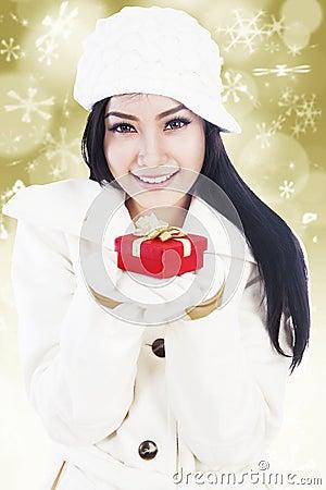 Beautiful christmas gift on golden lights