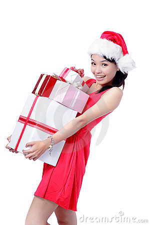 Beautiful Christmas Girl happy holding gift