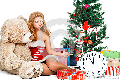 Beautiful christmas girl isolated white background near tree and toys Stock Photo