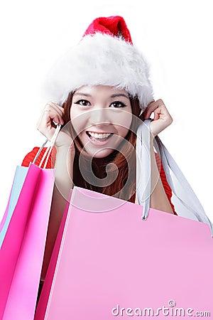 Beautiful Christmas woman happy take shopping bag