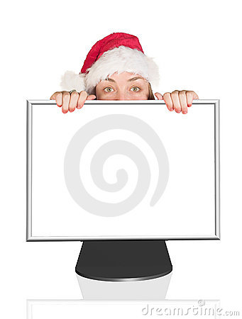 Beautiful Christmas woman peeping out of computer monitor