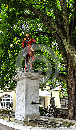 Free Beautiful City Street View Of The Colorful Medieval Messenger Statue On Top Of Elaborate Fountain In Bern, Switzerland. Stock Photos - 98124513