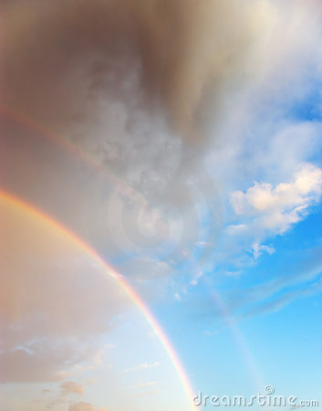 Beautiful cloudscape with rainbow