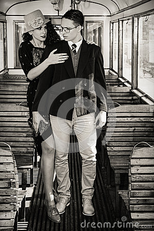 Beautiful composition of romantic fashion couple standing inside