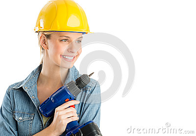 Beautiful Construction Worker With Power Drill Looking Away