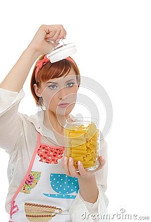 Beautiful cooking woman  with italian pasta