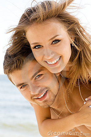 Free Beautiful Couple Having Fun On The Seaside Stock Image - 10711181