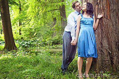 Beautiful couple having romantic moment in forest