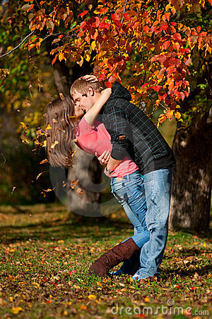 Beautiful couple kissing in autumn park