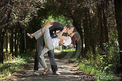 Beautiful couple kissing on a park
