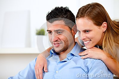 Beautiful couple in love looking something