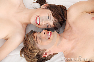 Beautiful couple lying in bed.