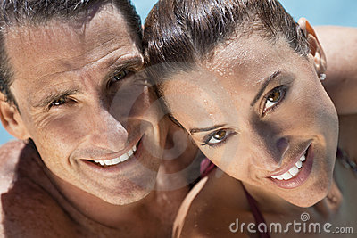 Beautiful Couple Relaxing In Swimming Pool
