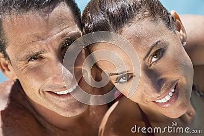Beautiful Couple Relaxing In Swimming Pool