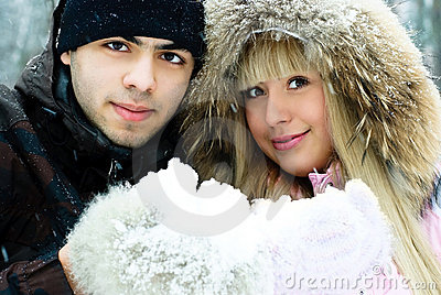 Beautiful couple spending time in winter park
