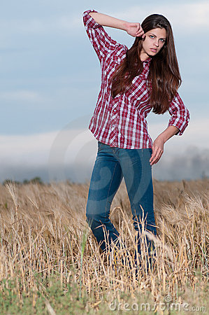 Free Beautiful Cowboy Woman Posing In Field Stock Photography - 17394142