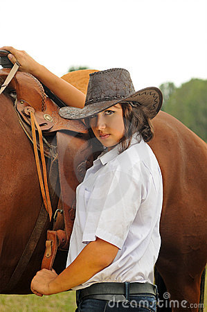 Free Beautiful Cowgirl With Her Horse Royalty Free Stock Photos - 18709868