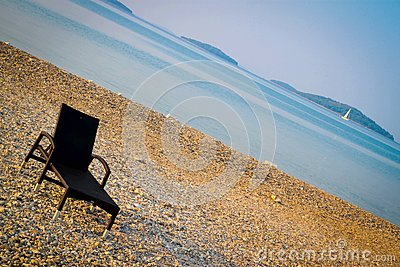 Beautiful croatian beach with one sunbed