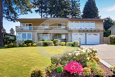 Beautiful curb appeal of two story house with beige for Beautiful two story homes