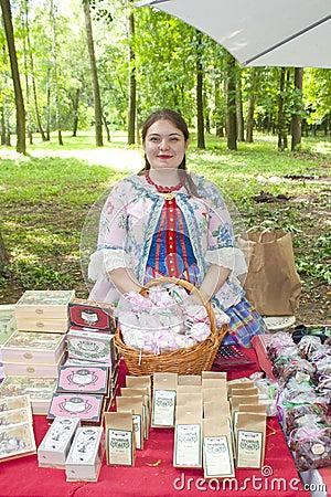 Free Beautiful Curly Bright Original Female Seller Of Handmade Marshmallows Stock Photo - 108328040