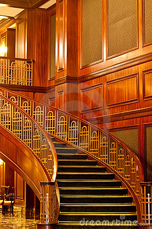 Beautiful Curving Stairs and Opulent Paneling