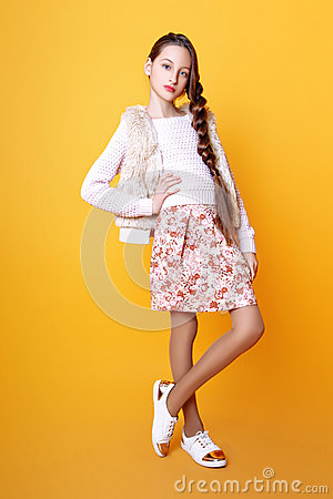 Free Beautiful Cute Fashion Girl Teenage In A Sweater And A Skir On Yellow Background With Long Hair Posing Royalty Free Stock Photo - 91956985