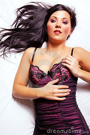 Beautiful dark hair woman on the bed