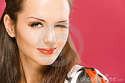 Beautiful dark-haired girl winks