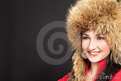 Beautiful dark haired girl in winter fur hat