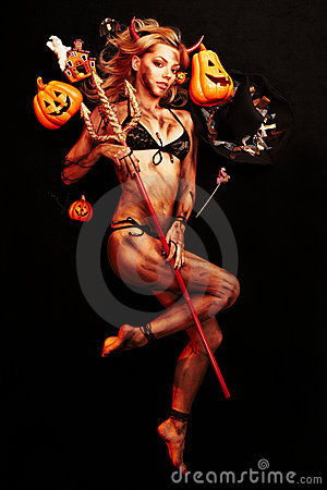 Beautiful devil with trident and Halloween accesso