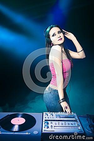 Beautiful DJ girl at the club