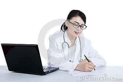 Beautiful doctor write prescription - isolated