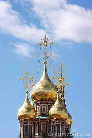 Beautiful domes of temple on a background blue sky