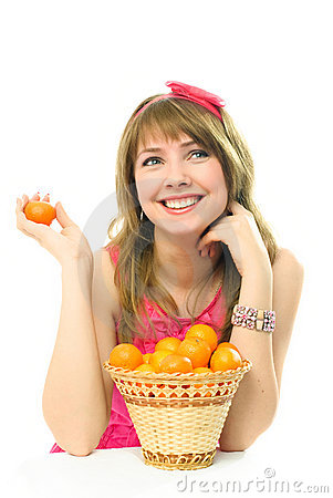 Beautiful dreamy girl with tangerines