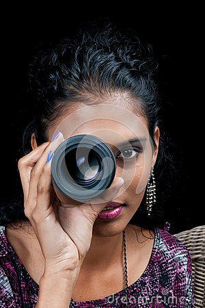 Beautiful east indian woman with camera lens