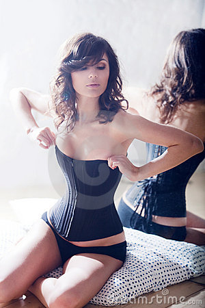 Beautiful elegant brunette in a corset.