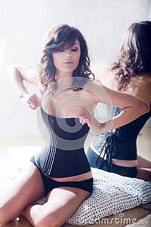 Beautiful elegant brunette in a corset.