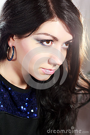 Beautiful elegant girl with an evening make-up