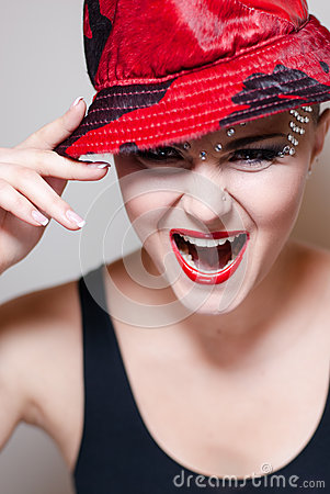 Elegant young woman with red hat & crystals shouting