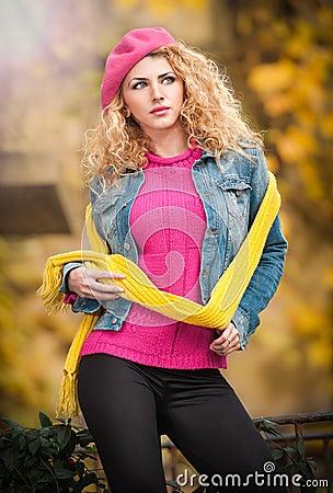 Beautiful elegant woman in autumn park