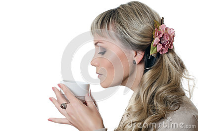 The beautiful elegant woman with a coffee cup